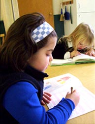 child reading montessori guelph
