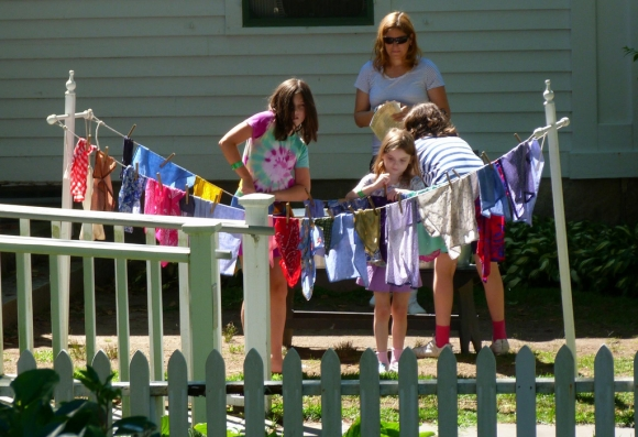Children Helping their mother do laundry