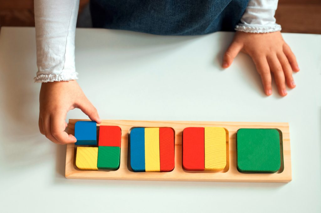 Children's hands with mathematics materials in a Montessori classroom